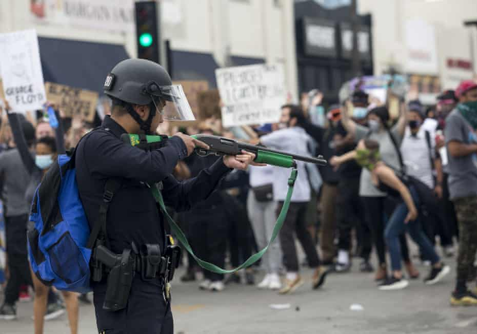 A police officer prepares to fire rubber bullets during a Los Angeles protest on 30 May over the death of George Floyd.