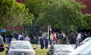 Law enforcement officers respond to an active shooter in front of Santa Fe high school Friday in Santa Fe, Texas.