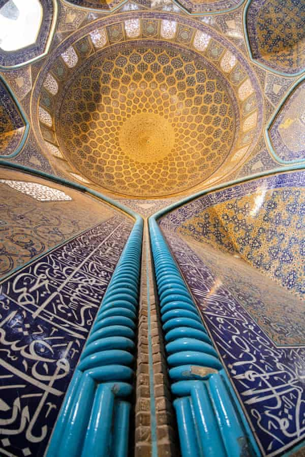 The tile-clad interior of the 17th-century Sheikh Lotfollah mosque in Isfahan, Iran.