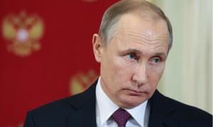 Vladimir Putin looks on during a press conference following talks with Moldova's President Igor Dodon January 2017