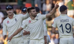 Mark Wood celebrates with his England teammates after dismissing Anrich Nortje.