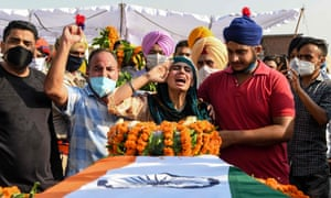 Sandeep Kaur and her brother Prabhjot Singh react after laying the wreaths of flowers on the coffin of their father and soldier Satnam Singh who was was killed in a recent clash with Chinese forces in the Galwan valley area