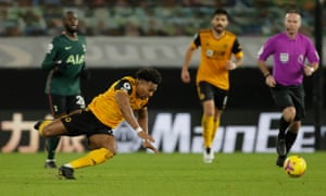 Adama Traore of Wolverhampton Wanderers fails in front of the ref.