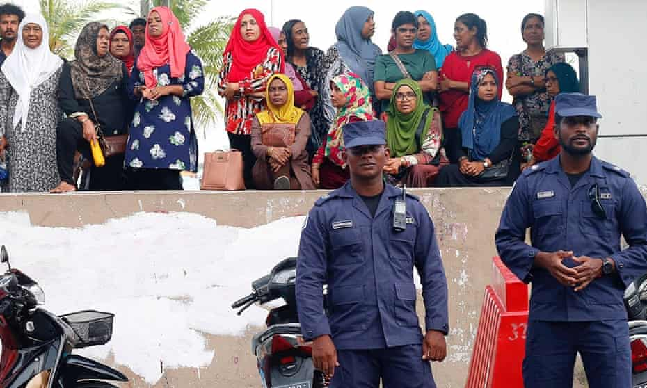 Maldivian police officers stand guard near the MDP opposition party headquarters after President Abdulla Yameen declared a state of emergency on 6 February.
