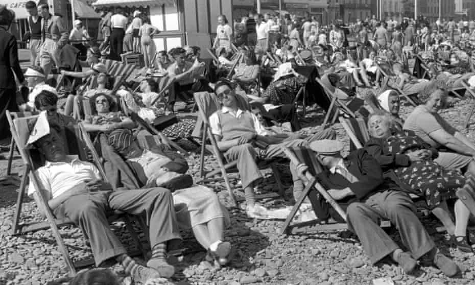 Tourists enjoying the sun on Douglas beach on the Isle of Man, 1939.