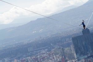 Mexico City Alexandrer Schultz of Germany walks on a wire across two of Mexico City's tallest buildings