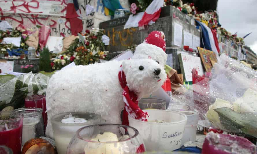 Flowers, candles and a polar teddy  in the Place de Republique on 21 November as Paris continues to remember its dead.