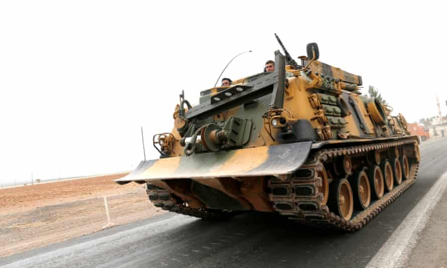 Turkish soldiers prepare for a military operation at the Syrian border.