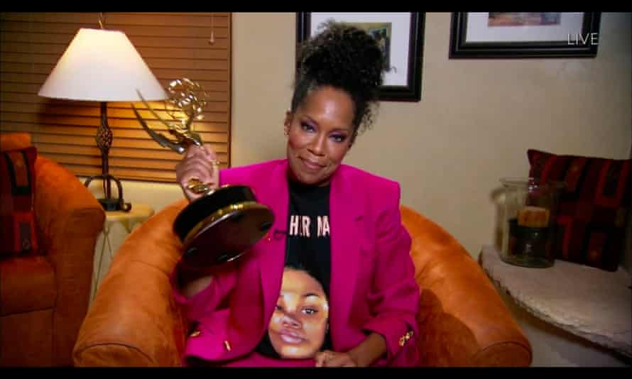 Regina King wearing a Breonna Taylor T-shirt as she wins the Emmy for outstanding lead actress in a limited series or movie for Watchmen in September.