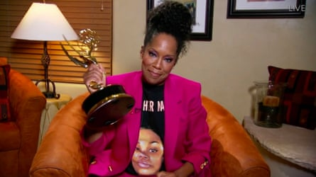 Regina King clutches her Emmy while wearing a Breonna Taylor T-shirt