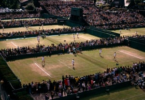 Spectators crowd around to watch the action on the outside courts in 1974.
