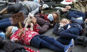 Protesters stage a die-in at an anti-pollution rally outside the Department for Transport in London on 27 April.