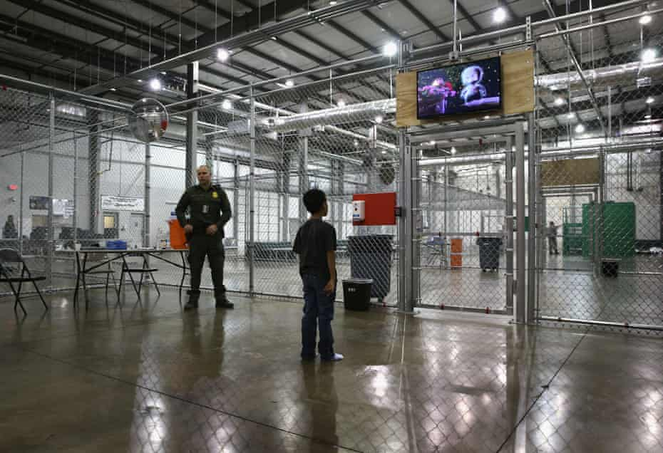 A boy from Honduras watches a movie at a detention facility in McAllen, Texas.