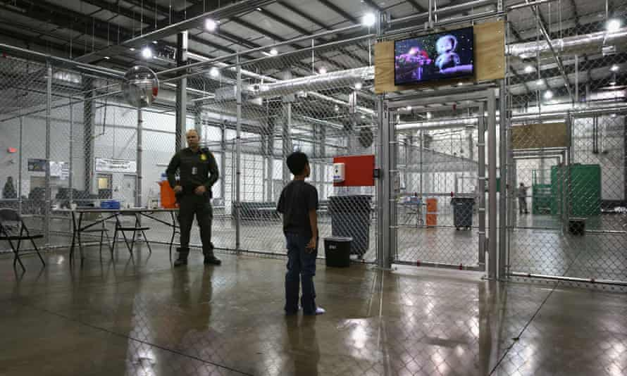 A boy from Honduras watches a movie at a detention facility run by the US border patrol in McAllen, Texas.