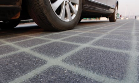 The world's first photovoltaic road is built with transparent concrete on top and can bear the weight of small vehicles and medium-sized trucks.
