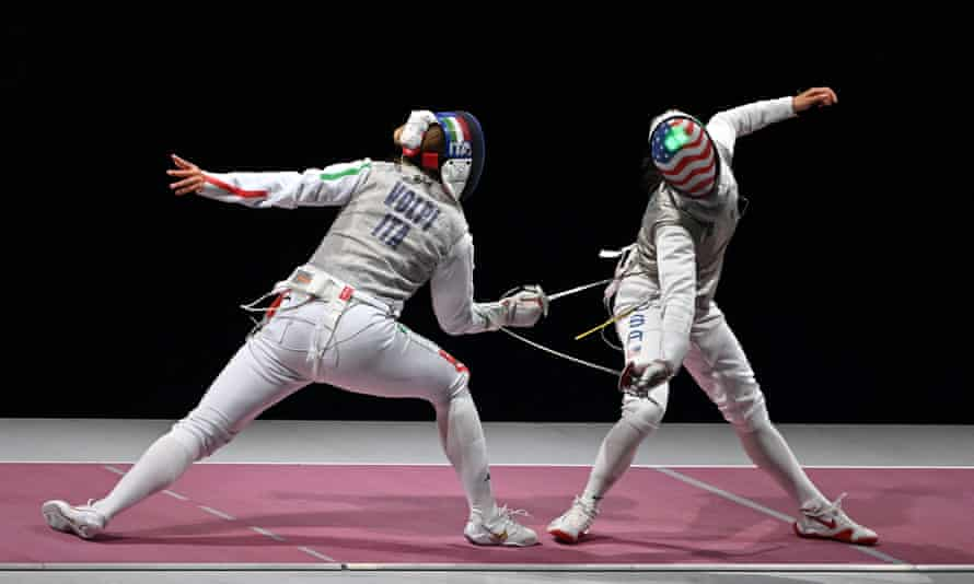 Lee Kiefer (right) faces Italy's Alice Volpiin in the women's team foil event.