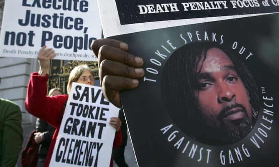 Opponents of the death penalty carry signs during a rally asking for Stanley 'Tookie' Williams to be spared of the death penalty in 2005.