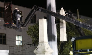 Workers dismantle the Liberty Monument in the early hours of Monday, which commemorates whites who tried to topple a biracial post-civil war government in New Orleans.