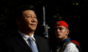 China's president, Xi Jinping, inspecting a guard of honour on his arrival in Athens.
