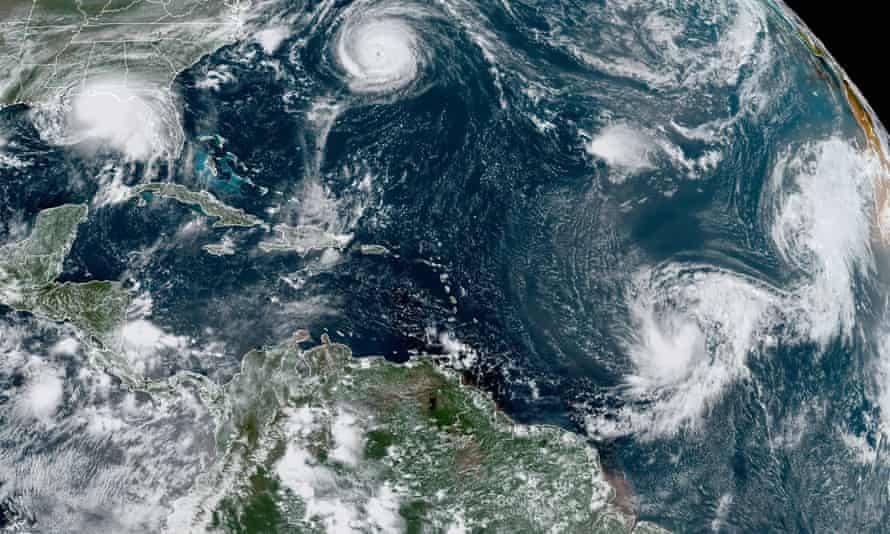 A NOAA satellite image showing five tropical cyclones churning in the Atlantic basin on Monday.