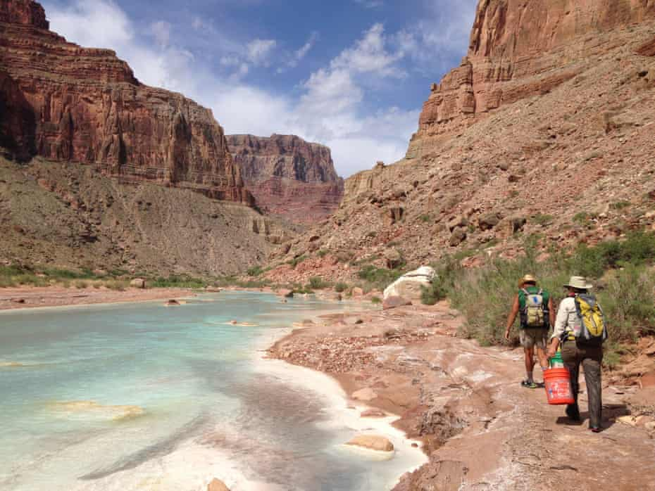 people walk along little colorado river