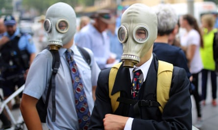 Student activists wear gas masks during the strike in Sydney.