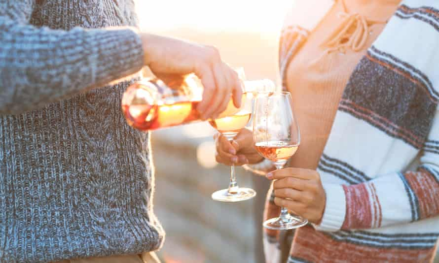 A couple with glasses of rosé