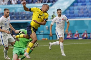 Sweden's Robin Quaison is fouled by Slovakia's goalkeeper Martin Dubravka and the ref points to the spot.