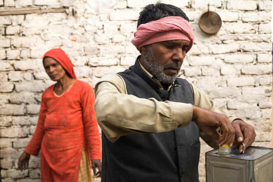 Saeeda and Azim in their home in Mewat district. They have nine children