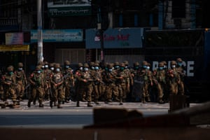 Soldiers after clashes with protesters on 3 March in Yangon, Myanmar. The military government has intensified a crackdown on protesters in recent weeks, using tear gas and live ammunition, charging at and arresting protesters and journalists.