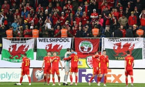 The Wales team and their fans celebrate at the end of their Euro 2020 qualifier against Azerbaijan in Baku in November 2019.