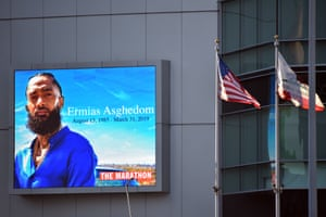 A sign outside the Staples Center bears the image of Nipsey Hussle, whose real name was Ermias Asghedom.