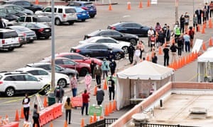 People wait in line at a Covid-19 testing center in Los Angeles, California on 8 December 2020.