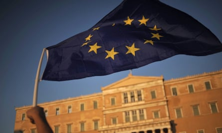 A pro-euro protester waves an EU flag outside the Greek parliament in Athens.