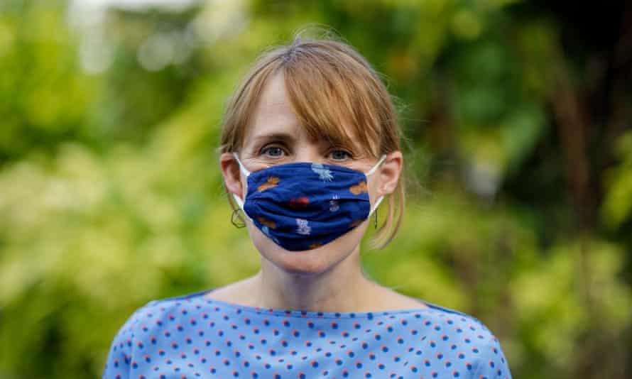 Woman wearing very small mask