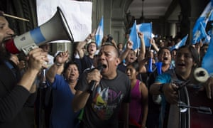 Demonstrators shout slogans against Guatemala's President Jimmy Morales at the National Palace of Culture in Guatemala City.