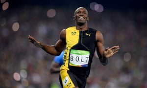 Usain Bolt celebrates winning the men's 100m final in Rio to claim his third consecutive gold medal in the event.
