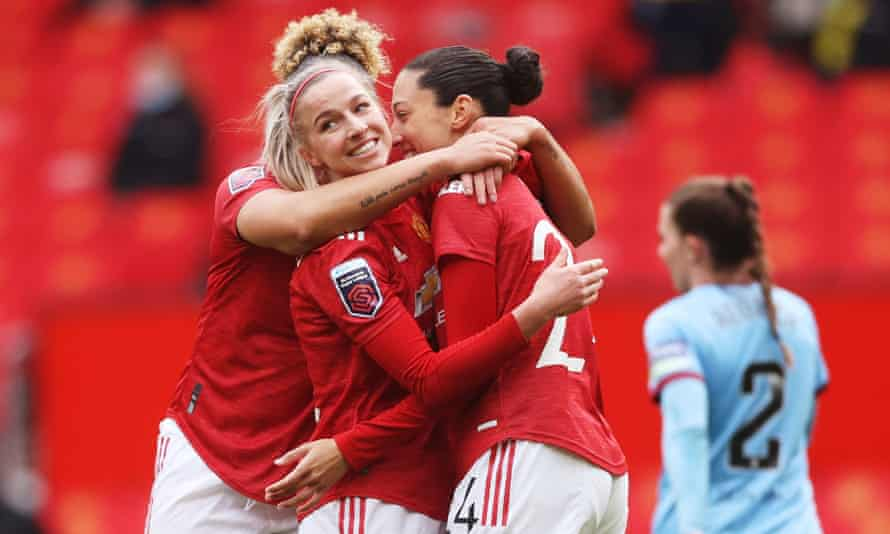 Christen Press (right) is congratulated after scoring Manchester United's second goal.
