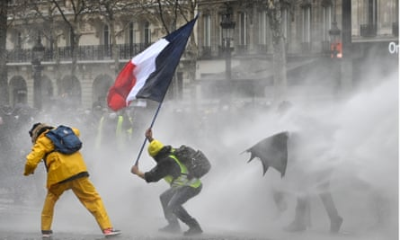 Riot police use water cannon to disperse 'yellow vests' on Avenue des Champs-Élysées in Paris on the 17th consecutive Saturday national protest.