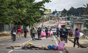 Gabon police clear barricades in Libreville.