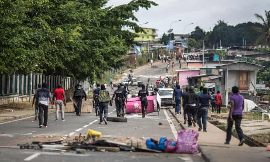 Gabon police clear barricades in Libreville.