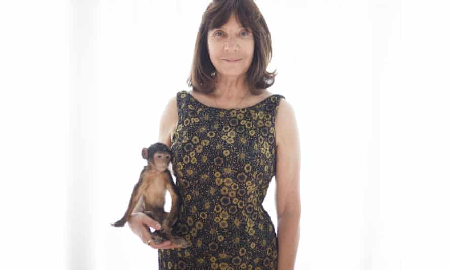 Calle holding her stuffed monkey.