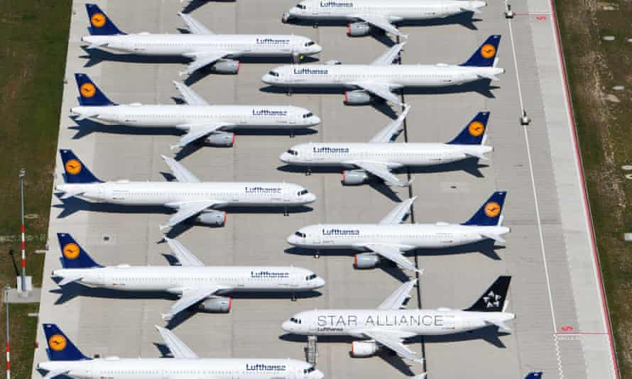 An aerial view shows air planes of Lufthansa sitting on the tarmac at the Berlin Brandenburg International Airport