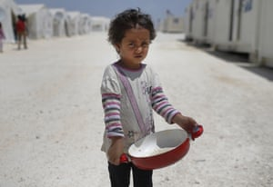 A Syrian child walks through a refugee camp in the Turkish town of Suruç, near the border with Syria.