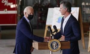 Joe Biden shakes hands with Gavin Newsom before speaking about recent wildfires.