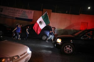 A man carrying a Mexican flag walks through downtown Tijuana to celebrate the country's recent independence day.