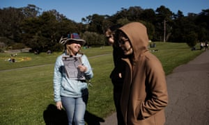 Teresa McGlashan, a volunteer for the Prevent Cruelty California campaign (and is also a marriage and family therapist based in Mill Vally), talking to two women about the campaign in Golden Gate Park, San Francisco.