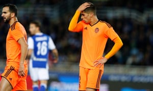 Valencia's defender Joao Cancelo strikes a familiar dehjected pose as his side lose 3-2 at Real Sociedad