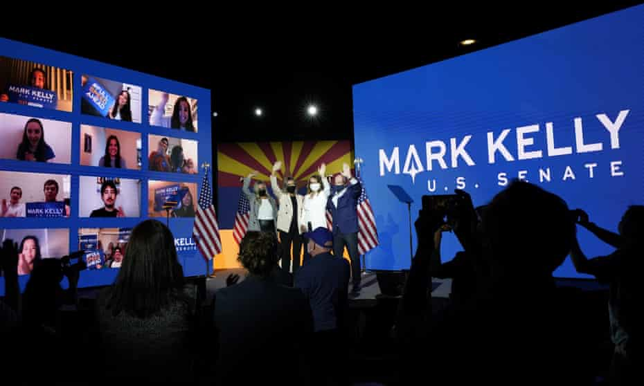 Mark Kelly, his wife Gabrielle Giffords and daughters Claudia and Claire celebrate Kelly's victory over Martha McSally for the US Senate.