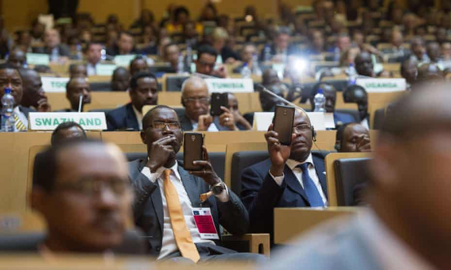 African leaders record President Barack Obama on their smartphones as he delivers a speech in Addis Ababa.